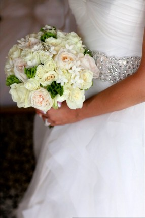Her bouquet consisted of all white flowers with a pop of green. White roses, stephanotis and bells of ireland