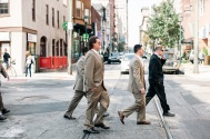 Guys wearing tan suits by Jones New York