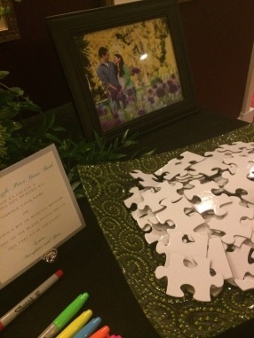 The couple loves puzzles (as do I), so instead of a traditional sign in book, they chose blank puzzle pieces for guests to write on - Photo by Angela MALICKI events